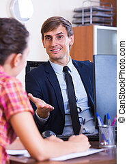 Insurance agent and customer discussing