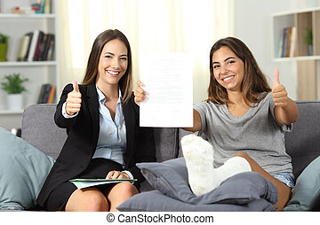 Insurance agent and disabled client with thumbs up
