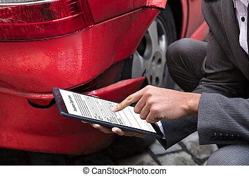 Insurance Agent Filling Insurance Claim Form On Digital Tablet