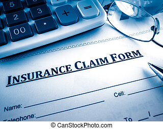 insurance claim form on the desk.