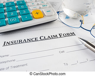 insurance claim form on the desk.