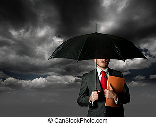 Insurance concept with business man and umbrella