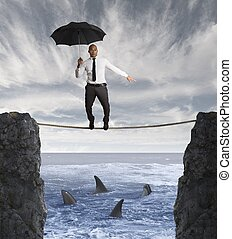 Insurance concept with businessman on a rope and shark in ...