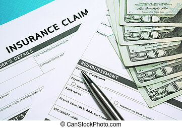Insurance concept with insurance claim form and money
