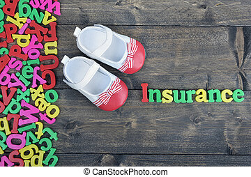 Insurance on wooden table - Insurance word on wooden table