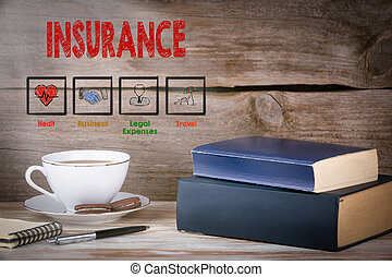 insurance., pilha livros, ligado, escrivaninha madeira