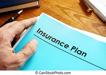Insurance Plan policy papers on desk.