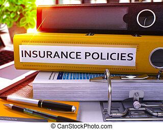 Insurance Policies - Yellow Ring Binder on Office Desktop with Office Supplies and Modern Laptop. Insurance Policies Business Concept on Blurred Background. 3D Render.
