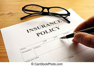 insurance policy form on desk in office showing risk concept