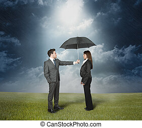 Insurance protection concept. Businessman protect a woman...