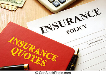 Insurance quotes book and policy on a desk.