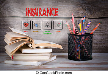 Insurance. Stack of books and pencils on the wooden table