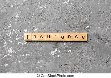insurance word written on wood block. insurance text on table, concept