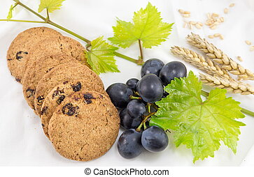 Integral cookies with grapes on white