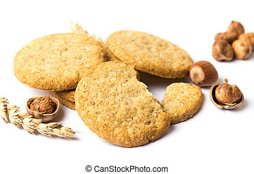 Integral cookies with hazelnuts and linseed on white