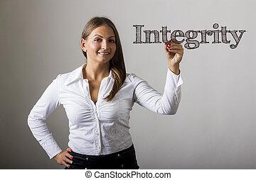 Integrity - Beautiful girl writing on transparent surface - horizontal image