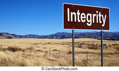 Integrity road sign with blue sky and wilderness