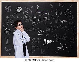intelligence - child in front of the blackboard thinking to...