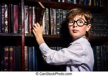 intelligent boy in a library