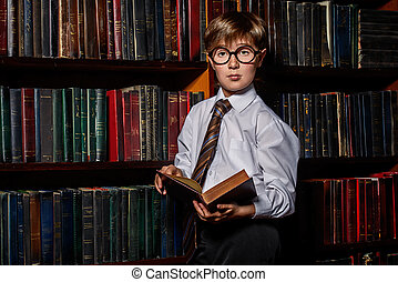 intelligent boy in glasses