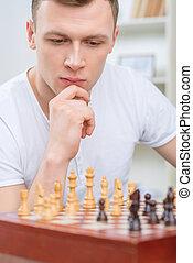 Intelligent man playing chess