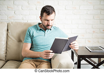 Intelligent man reading
