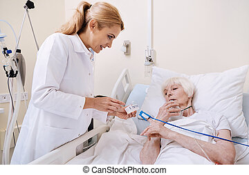 Intelligent senior woman asking questions about medication