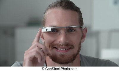 Intelligent Technologies - Close up of man wearing smart...