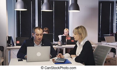 Female and man discussing important startup project and...