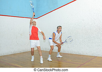 intense badminton game