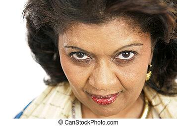 Intense Eyes - A closeup of a beautiful, mature woman. White...