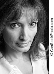 Intense Eyes B&W - A closeup of a beautiful woman with green...