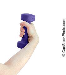 Intense female hand holds a dumbbell