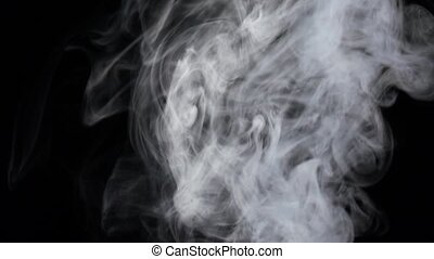 Intense flow of white fog streams from bottom, slow motion