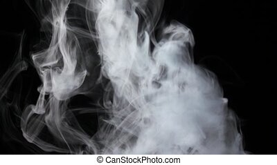 Intense flow of white fog streams from bottom, black background