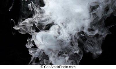Intense jet of white smoke streams from bottom, black background