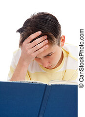 Intense study for exams - A teenage student reading and ...