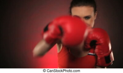 Intense woman boxer throwing punches - Intense beautiful...