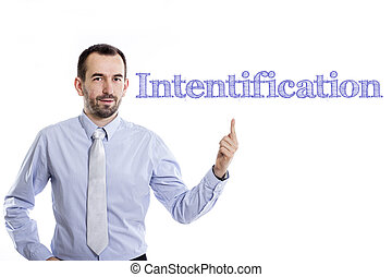 Intentification - Young businessman with small beard pointing up in blue shirt