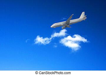 Airliner landing against a blue sky.
