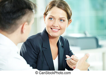 Interacting female - A woman manager looking at business...