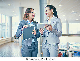 Interacting females - Image of confident businesswomen...