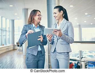 Interacting females - Image of confident businesswomen ...