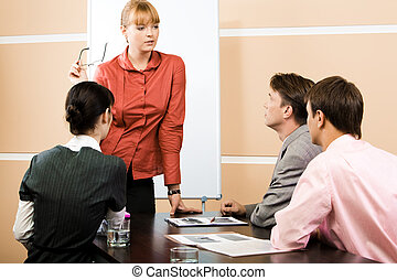 Image of smart teacher explaining new topic to students at lecture