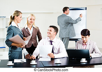 Interaction - Image of business group discussing new project...