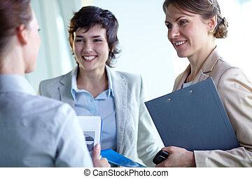 Interaction - Image of confident businesswomen interacting...