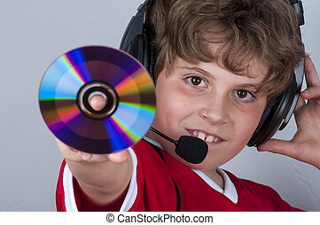 Interactive, Blonde boy with music helmet on his head and musical records or cds in his hands