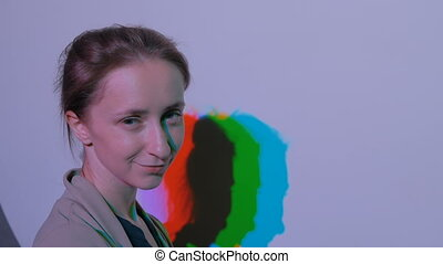 Portrait of woman with colored shadows