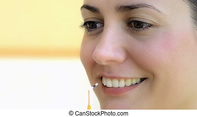 Interdental Brush - Young woman using interdental brush