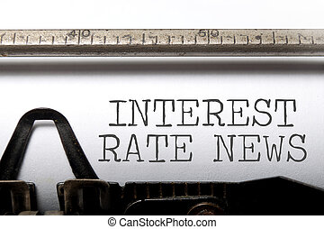 Interest rate news - Interest rates headline printed on an...